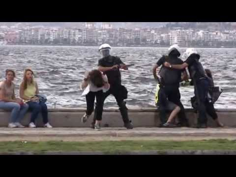A harmless girl getting hit in the head with a stick in Izmir